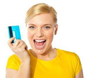 happy girl showing her credit card