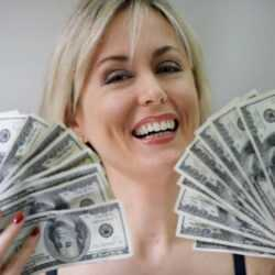Happy Woman Fanning Out Money