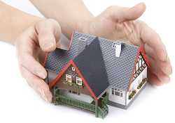 protecting home with hands - hazard insurance concept