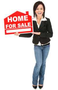 real estate women holding a home for sale sign
