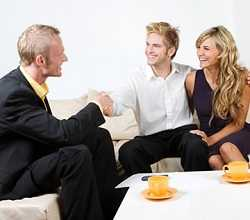 financial adviser briefing to a young couple