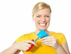 girl cutting her credit card with scissors