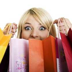 girls shocked and surprised while holding shopping bags