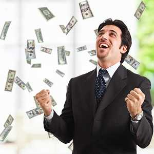 rich happy man with money raining